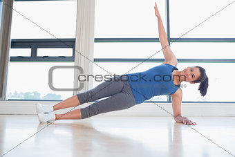 Happy woman in yoga pose