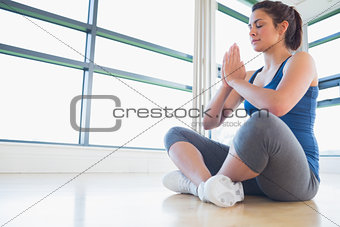 Women meditating in sitting yoga pose
