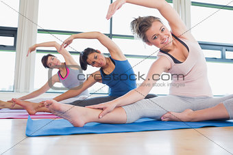 Women stretching at yoga class