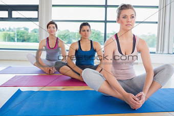 Women sitting in bound angle yoga pose