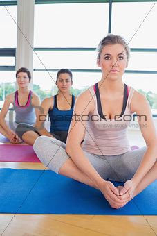 Women in bound angle yoga pose