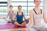 Women sitting in easy yoga pose