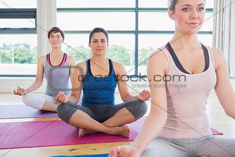 Women sitting in easy yoga pose