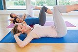 Happy women doing core exercise