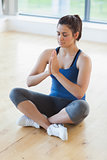 Woman sitting on the floor in yoga pose
