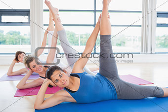 Women stretching on mats