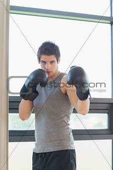 Man standing while boxing
