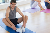 Man at yoga class