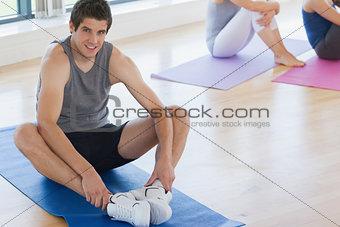 Man at yoga class