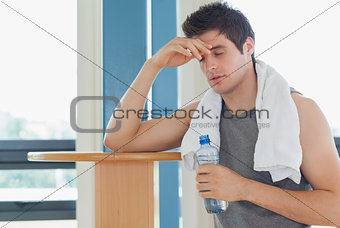 Man taking a break from working out