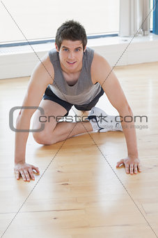 Man sitting stretching his leg