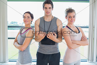 Trainer standing between two women