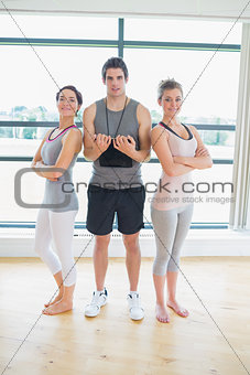Smiling trainer with women