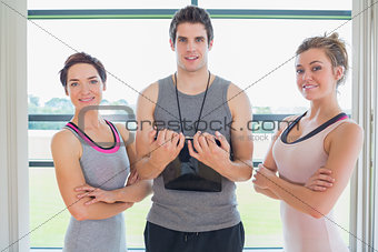 Trainer standing between two smiling women