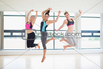 Women jumping in fitness studio