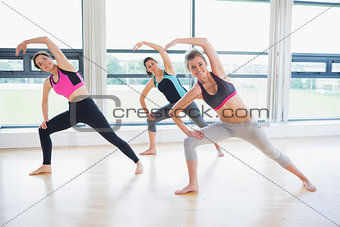 Women stretching in fitness studio