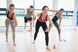 People in aerobics class lifting weights