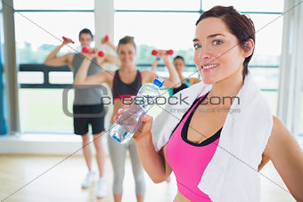 Woman taking break from aerobics class