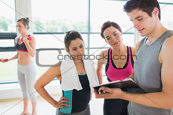 Trainer and women talking