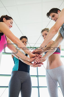 People putting hands together at the sports hall