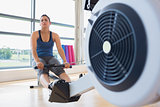 Woman taking break from rowing machine