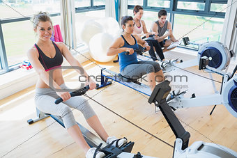 People sitting at the row machine