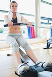 Woman on the rowing machine
