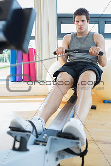 Man sitting at the row machine