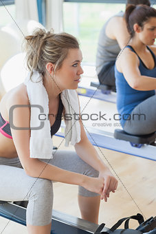 Woman taking a break from the row machine