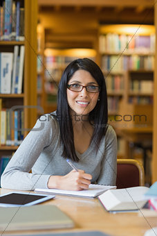 Black-haired woman doing some research