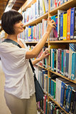 Woman choosing a book from the shelves
