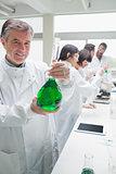 Chemist holding beaker
