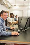 Cheerful man using the computer