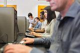 Teacher helping her students in computer class