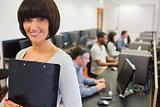 Teacher smiling in computer class