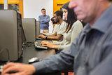 Teacher standing at front of computer class