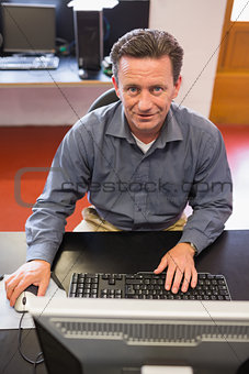 Mature student happily working on computer