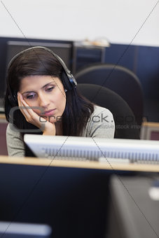 Tired woman in computer room
