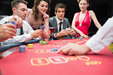 People playing exciting game of poker