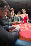 People playing at the poker table