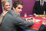 Couple smiling as man is taking his winnings