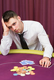 Man looking unhappy at poker table