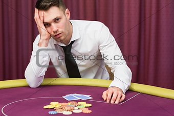 Man looking worried at poker table