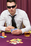 Man in sunglasses playing poker