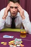 Man losing his house at poker game