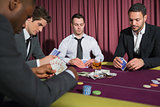 Men playing high stakes poker game