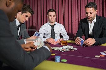 Men playing high stakes poker game