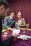 Happy couple playing poker