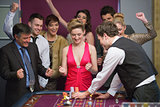 People cheering at roulette table