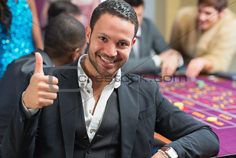Smiling an thumbs up at roulette table